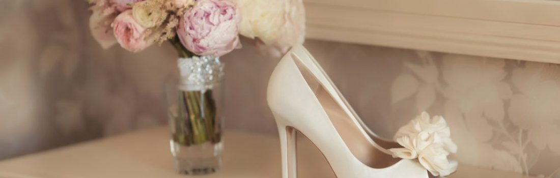 Bridal bouquet and ivory high heels shoes. Wedding details
